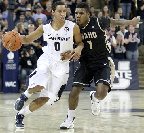 Idaho's Denzel Douglas (1) guards Utah State's Marcel Davis during an NCAA college basketball game Saturday, Jan. 5, 2013, in Logan, Utah. (AP Photo/The Herald Journal, John Zsiray)