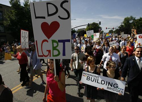 Scott Sommerdorf  |  The Salt Lake Tribune              Mormons Building Bridges group leads the annual Gay Pride Parade through downtown Salt Lake City, Sunday, June 3, 2012.