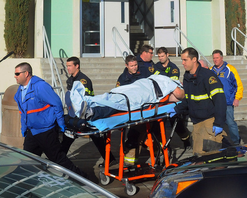 This image provided by the Taft Midway Driller/Doug Keeler shows paramedics transporting a student wounded during a shooting Thursday Jan. 10, 2013 at San Joaquin Valley high school in Taft, Calif. Authorities said a student was shot and wounded and another student was taken into custody. (AP Photo/Taft  Midway Driller, Doug Keeler)