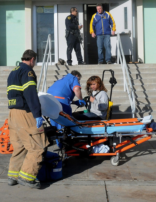 This image provided by the Taft Midway Driller/Doug Keeler shows paramedics assisting a student wounded during a shooting Thursday Jan. 10, 2013 at San Joaquin Valley high school in Taft, Calif. Authorities said a student was shot and wounded and another student was taken into custody. (AP Photo/Taft  Midway Driller, Doug Keeler)