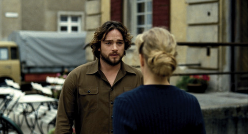 """Courtesy photo Dr. Barbara Wolff (Nina Hoss, back to camera) confronts her colleague, Andre (Ronald Zehrfeld), of spying on her in the drama """"Barbara."""""""