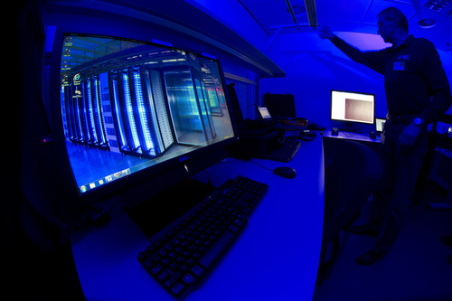 A member of the Cybercrime Center turns on the light in a lab during a media tour at the occasion of the official opening of the Cybercrime Center at Europol headquarters in The Hague, Netherlands, Friday Jan. 11, 2013. The lab is housed in a cage of Faraday and is used amongst others to analyze computer hard disks, mobile phones and smart phones. (AP Photo/Peter Dejong)