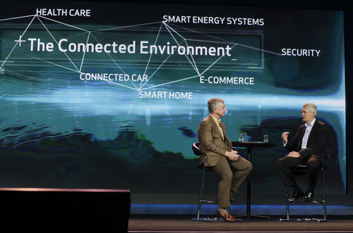 Verizon CEO Lowell McAdam, left, talks with Ford chief technology officer and vice president Paul Mascarenas about Ford's Sync in-vehicle communication and entertainment system during a keynote address at the Consumer Electronics Show, Tuesday, Jan. 8, 2013, in Las Vegas. (AP Photo/Julie Jacobson)