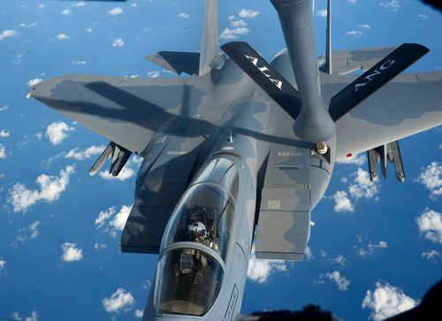 """A Florida Air National Guard F-15C """"Eagle"""" takes on fuel from an Alabama Air National Guard KC-135R """"Stratotanker"""" over the Gulf of Mexico off Florida on an aerial refueling flight Thursday, Jan. 10, 2013.  (AP Photo/ AL.com, Mark Almond)"""
