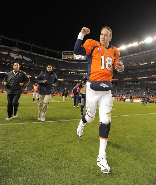 Denver Broncos quarterback Peyton Manning (18) reacts as he runs off the field after the Broncos defeated the New Orleans Saints 34-14 in an NFL football game, Sunday, Oct. 28, 2012, in Denver. (AP Photo/Jack Dempsey)