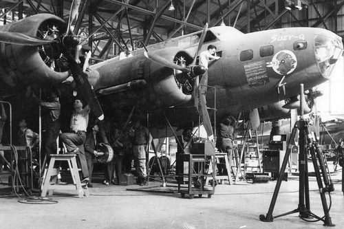 """(Courtesy Utah State Historical Society)  """"Suzy-Q,"""" the first B-17 to arrive at OOAMA, July 19, 1943."""