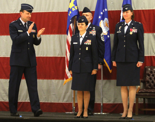 Rick Egan  | The Salt Lake Tribune   Lt. Gen. Bruce A. Litchfield, commander of the Air Force Sustainment Center (AFSC) (left), applauds Col. Kathryn L. Kolbe (center) and Col. Sarah E. Zabel (right) during the change-of-command ceremony at Hill Air Force Base, Friday, January 11, 2013. Kolbe assumed command of the 75th Air Base Wing from Zabel.