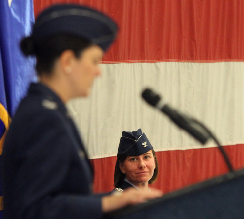 Rick Egan  | The Salt Lake Tribune   Col. Sarah E. Zabel (right) listens as Col. Kathryn L. Kolbe (left) speaks to the 75th Air Base Wing during the change-of-command ceremony at Hill Air Force Base, Friday, January 11, 2013. Kolbe assumed command of the 75th Air Base Wing from Zabel.