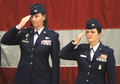 Rick Egan  | The Salt Lake Tribune   Col. Sarah E. Zabel (left) and Col. Kathryn L. Kolbe (right) salute during the change-of-command ceremony at Hill Air Force Base on Friday. Kolbe assumed command of the 75th Air Base Wing from Zabel.