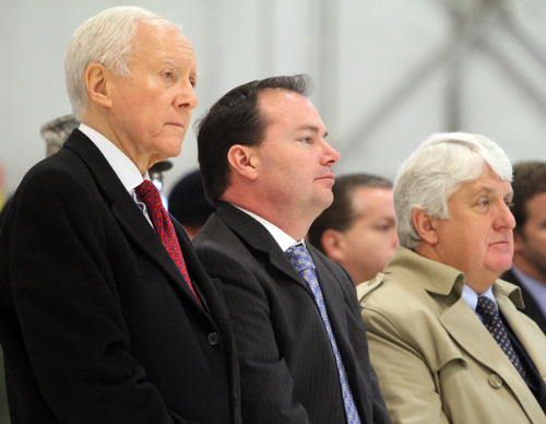 Rick Egan  | The Salt Lake Tribune   Senators Orrin Hatch, Mike Lee and Congressman Rob Bishop stand at attention during the change-of-command ceremony for  Col. Kathryn L. Kolbe  at Hill Air Force Base, Friday, January 11, 2013. Kolbe assumed command of the 75th Air Base Wing from Col. Sarah E. Zabel.