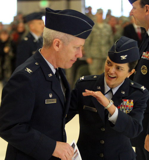 Rick Egan  | The Salt Lake Tribune Col. Kathryn L. Kolbe, right, and her husband, Col. Rick LeBlanc, talk after the change-of-command ceremony at Hill Air Force  Base on Friday. Kathryn Kolbe assumed command of the 75th Air Base Wing from Col. Sarah E. Zabel.