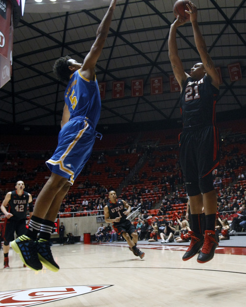 Chris Detrick  |  The Salt Lake Tribune Utah Utes forward Jordan Loveridge (21) shoots past UCLA Bruins guard Kyle Anderson (5) during the first half of the game at the Huntsman Center Thursday January 10, 2013.
