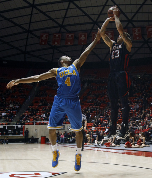 Chris Detrick  |  The Salt Lake Tribune Utah Utes guard Cedric Martin (43) shoots over UCLA Bruins guard Norman Powell (4) during the first half of the game at the Huntsman Center Thursday January 10, 2013.