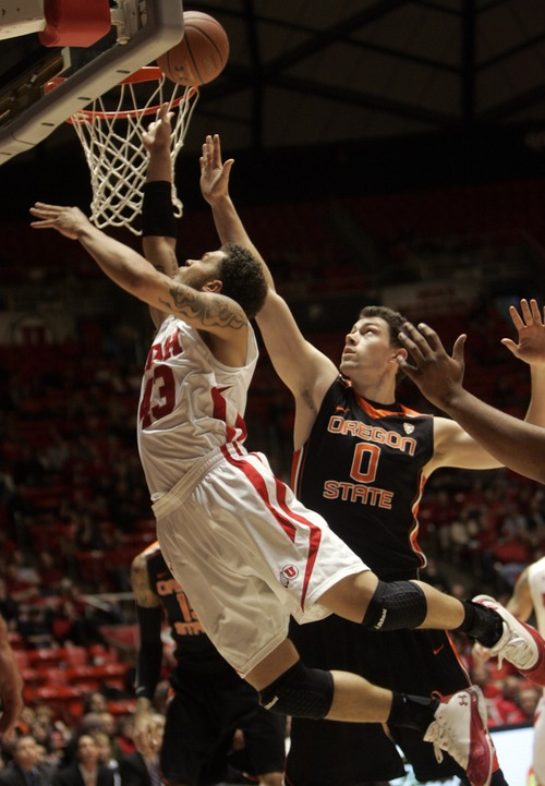 Kim Raff |The Salt Lake Tribune University of Utah player Cedric Martin makes a layup over Oregon State player Kevin McShane during the first half at the Huntsman Center in Salt Lake City, Utah on February 4, 2012.