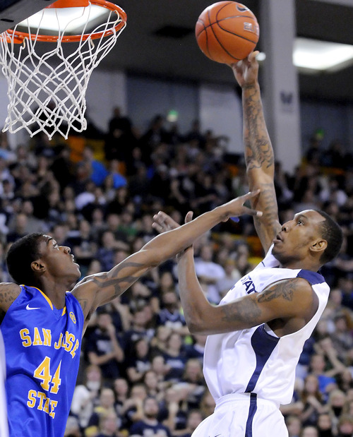 Utah State center Jarred Shaw, right, takes a shot over San Jose State center Alex Brown (44) during an NCAA college basketball game Friday, Jan. 11, 2013, in Logan, Utah. (AP Photo/The Herald Journal, Eli Lucero)