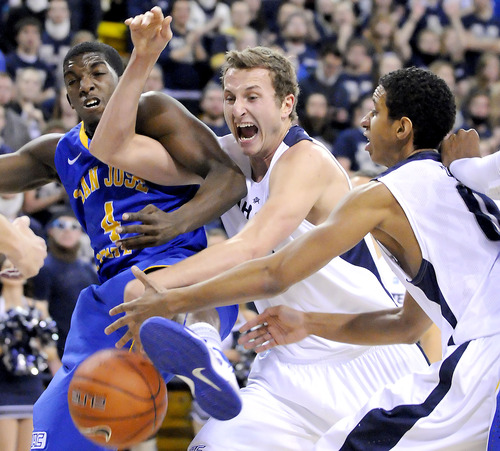 Utah State forward Ben Clifford, center, and and teammate guard Marcel Davis, right, fight for a rebound against San Jose State guard Aalim Moor (4)  during an NCAA college basketball game Friday, Jan. 11, 2013, in Logan, Utah. (AP Photo/The Herald Journal, Eli Lucero)