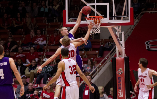 Asher Swan | The Spectrum &  Daily News Kyle Tresnak of Weber State dunks the ball over the Southern Utah's defense during their rival game in the Centrum arena on Thursday January 10, 2012.
