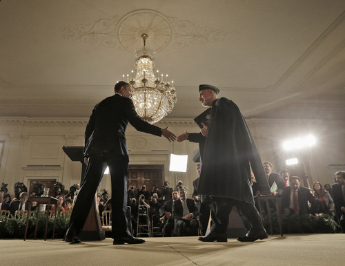 President Barack Obama and Afghan President Hamid Karzai shake hands at the conclusion of their joint news conference in the East Room of the White House in Washington, Friday, Jan. 11, 2013. (AP Photo/Pablo Martinez Monsivais)