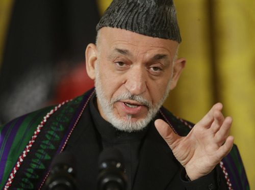 Afghan President Hamid Karzai gestures as he answers questions during a joint news conference with President Barack Obama in the East Room of the White House in Washington, Friday, Jan. 11, 2013. (AP Photo/Pablo Martinez Monsivais)