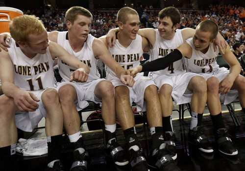 Trent Nelson  |  Tribune Fiel Photo Lone Peak's Brody Berry, far right, celebrates on the bench with  T.J. Haws, Talon Shumway, Chase Hansen and Nick Emery in the fourth quarterof the Class 5A high school state championship game in March.