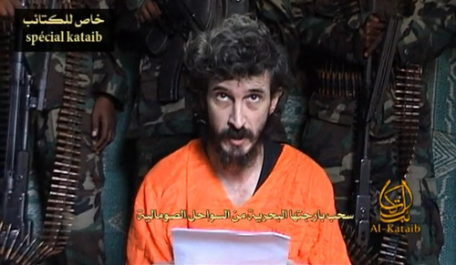 FILE- In this undated file image from a video posted on islamic militant websites  and made available Wednesday June 9 2010, a man identified as French security agent Denis Allex pleads for his release from the Somali militant group al-Shabaab who have been holding him for nearly a year. A French commando raid in Somalia to free a captive intelligence agent ended in the deaths of 17 Islamists and a French soldier. France said the hostage also died in the failed rescue, but the man's captors denied he had been killed and claimed Saturday, Jan. 12, 2013, to have seized a second soldier. (AP Photo, File)