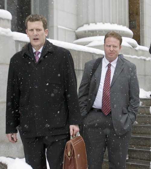 Paul Fraughton | The Salt Lake Tribune  Jeremy Johnson, right, leaves the federal courthouse with his attorney, Nathan Crane, in Salt Lake City on Friday.