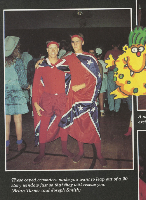 This photo from the 1992 edition of The Confederate, Dixie State College's yearbook, shows students Brian Turner and Joseph Smith wearing Confederate flags as capes.