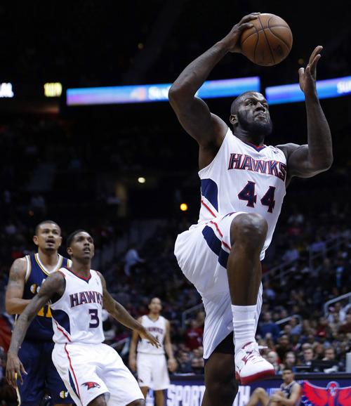 Atlanta Hawks power forward Ivan Johnson (44) scores in the second half of an NBA basketball game against the Utah Jazz, Friday, Jan. 11, 2013, in Atlanta. Atlanta won 103-95. (AP Photo/John Bazemore)