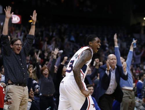 Atlanta Hawks shooting guard Louis Williams (3) reacts after scoring late in the second half of an NBA basketball game against the Utah Jazz, Friday, Jan. 11, 2013, in Atlanta.  Atlanta won 103-95. (AP Photo/John Bazemore)