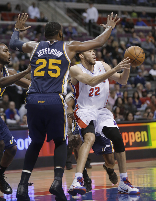 Detroit Pistons forward Tayshaun Prince (22) passes the ball as Utah Jazz center Al Jefferson (25) defends during the first quarter of an NBA basketball game at the Palace of Auburn Hills, Mich., Saturday, Jan. 12, 2013. (AP Photo/Carlos Osorio)