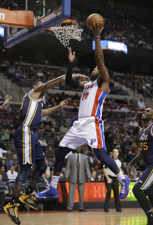 Utah Jazz guard Mo Williams, left, defends on a shot by Detroit Pistons center Greg Monroe (10) during the first quarter of an NBA basketball game at the Palace of Auburn Hills, Mich., Saturday, Jan. 12, 2013. (AP Photo/Carlos Osorio)