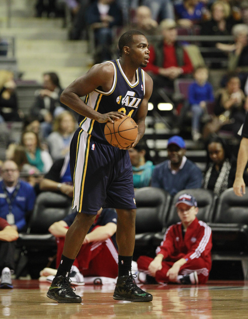 Utah Jazz forward Paul Millsap looks to pass during the second quarter of an NBA basketball game against the Detroit Pistons at the Palace of Auburn Hills, Mich., Saturday, Jan. 12, 2013. (AP Photo/Carlos Osorio)