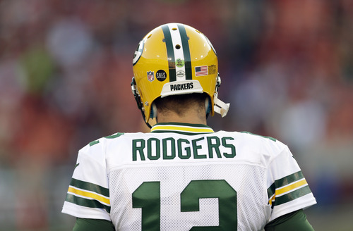 Green Bay Packers quarterback Aaron Rodgers (12) warms up before an NFC divisional playoff NFL football game against the Green Bay Packers in San Francisco, Saturday, Jan. 12, 2013. (AP Photo/Marcio Jose Sanchez)