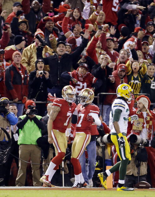 San Francisco 49ers quarterback Colin Kaepernick (7) celebrates with wide receiver A.J. Jenkins (17) after scoring on a touchdown run against the Green Bay Packers during the first quarter of an NFC divisional playoff NFL football game in San Francisco, Saturday, Jan. 12, 2013. (AP Photo/Ben Margot)