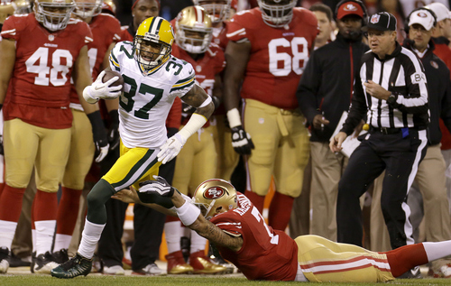 Green Bay Packers cornerback Sam Shields (37) runs past San Francisco 49ers quarterback Colin Kaepernick (7) while returning an interception for a touchdown during the first quarter of an NFC divisional playoff NFL football game in San Francisco, Saturday, Jan. 12, 2013. (AP Photo/Ben Margot)