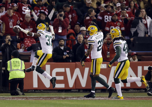 Green Bay Packers cornerback Sam Shields (37) celebrates as he returns an interception for a touchdown during the first quarter of an NFC divisional playoff NFL football game in San Francisco, Saturday, Jan. 12, 2013.(AP Photo/Marcio Jose Sanchez)