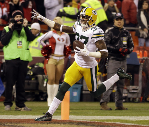Green Bay Packers cornerback Sam Shields (37) celebrates after returning an interception from San Francisco 49ers quarterback Colin Kaepernick for a touchdown during the first quarter of an NFC divisional playoff NFL football game in San Francisco, Saturday, Jan. 12, 2013. (AP Photo/Ben Margot)