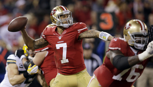 San Francisco 49ers quarterback Colin Kaepernick (7) makes a pass in the first quarter of an NFC divisional playoff NFL football game against the Green Bay Packers in San Francisco, Saturday, Jan. 12, 2013. (AP Photo/Marcio Jose Sanchez)