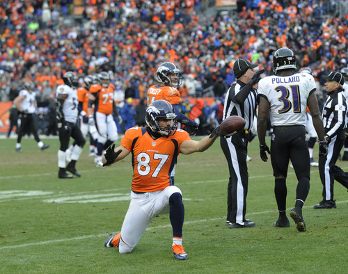 Denver Broncos wide receiver Eric Decker (87) reacts after catching a pass for a first down against the Baltimore Ravens in the second quarter of an AFC divisional playoff NFL football game, Saturday, Jan. 12, 2013, in Denver. (AP Photo/Jack Dempsey)