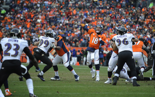 Denver Broncos quarterback Peyton Manning (18) passes against the Baltimore Ravens in the second quarter of an AFC divisional playoff NFL football game, Saturday, Jan. 12, 2013, in Denver. (AP Photo/Jack Dempsey)