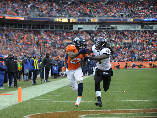 Denver Broncos running back Knowshon Moreno (27) catches a touchdown pass against Baltimore Ravens inside linebacker Dannell Ellerbe (59) in the second quarter of an AFC divisional playoff NFL football game, Saturday, Jan. 12, 2013, in Denver. (AP Photo/Jack Dempsey)