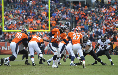 Denver Broncos quarterback Peyton Manning (18) hands the ball off to Denver Broncos running back Knowshon Moreno (27) against the Baltimore Ravens in the first quarter of an AFC divisional playoff NFL football game, Saturday, Jan. 12, 2013, in Denver. (AP Photo/Jack Dempsey)