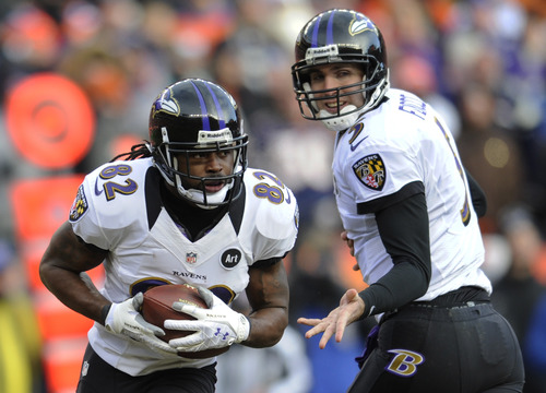 Baltimore Ravens quarterback Joe Flacco, right, hands the ball off  to wide receiver Torrey Smith in the second quarter of an AFC divisional playoff NFL football game, Saturday, Jan. 12, 2013, in Denver. (AP Photo/Jack Dempsey)