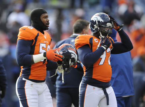 Denver Broncos outside linebacker Von Miller (58) and defensive end Elvis Dumervil (92) prepare to play the Baltimore Ravens in an AFC divisional playoff NFL football game, Saturday, Jan. 12, 2013, in Denver. (AP Photo/Jack Dempsey)