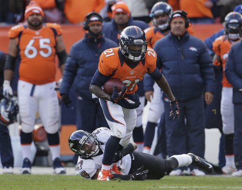 Denver Broncos running back Ronnie Hillman (21) is tripped up by Baltimore Ravens cornerback Cary Williams (29) in the first quarter of an AFC divisional playoff NFL football game, Saturday, Jan. 12, 2013, in Denver. (AP Photo/Charlie Riedel)