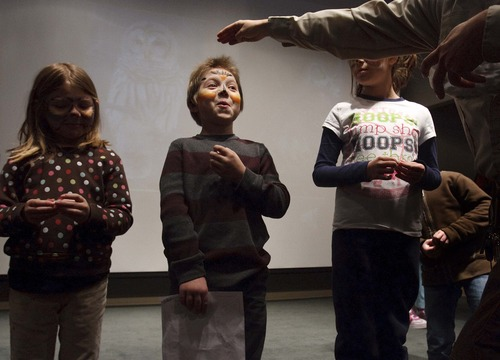 Leah Hogsten  |  The Salt Lake Tribune Justine Reeves, 6, left, and her brother Wesley Reeves, 9, of Brigham City, hoot the call of a Barred Owl in the hooting competition during Bear River Migratory Bird Refuge's Owl Day on Saturday. Wesley won third place for his call.