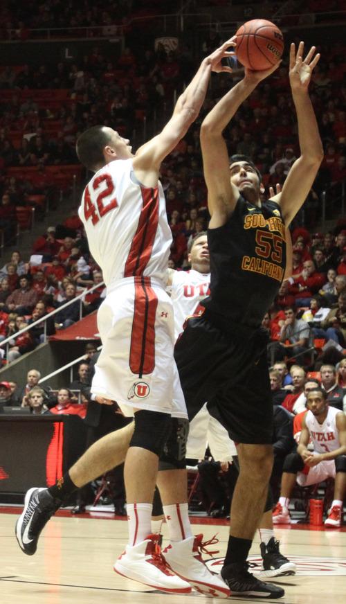 Rick Egan    The Salt Lake Tribune   Utah Utes center Jason Washburn (42) blocks a shot by USC Trojans guard J.T. Terrell (20) in basketball action Utah vs. USC, at  the Huntsman Center, Saturday, January 12, 2013.