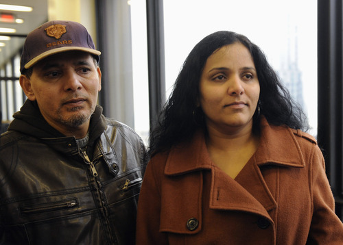 Meraj Khan, right, and Ferozo Khan, sister and brother of Illinois lottery winner Urooj Kahn, who was fatally poisoned with cyanide in July 2012 just as he was about to collect $425,000 in lottery winnings, leave a Cook County courtroom Friday, Jan. 11, 2013, after a judge granted permission to have their brother's body exhumed. Meraj said she hoped her brother would rest in peace but understands a decision to exhume his body. (AP Photo/Chicago Sun-Times, John  H. White) CHICAGO LOCALS OUT, MAGS OUT