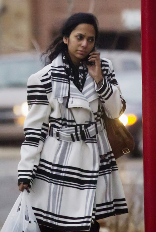 In this Thursday, Jan. 10. 2013 photo, Shabana Ansari, the wife of Urooj Khan, exits a dry cleaners in Chicago, Ill. Khan, 46, who owned several dry cleaning operations and some real estate, died suddenly on July 20, 2012, just days before he was to collect his winnings. Khan's death has been ruled a homicide. Court records show that Ansari has battled with his siblings over control of his estate, including his $425,000 prize money. A Cook County judge on Friday, Jan. 11, 2013, approved the exhumation of Khan's body.  (AP Photo/Chicago Sun-Times, Andrew A. Nelles) CHICAGO LOCALS OUT, MAGS OUT