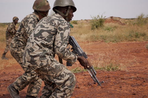 "In this Nov. 24, 2012 photo, soldiers from a Malian army run during a training exercise in the Barbe military zone, in Mopti, Mali. Secretary-General Ban Ki-moon said Friday, Jan. 11, 2013 that France, Senegal and Nigeria have responded to an appeal from Mali's President Dioncounda Traore for help to counter an offensive by al-Qaida-linked militants who control the northern half of the country and are heading south. The U.N. chief said that assisting the Malian defense forces push back against the Islamist armed groups is ""very important.""(AP Photo/Francois Rihouay)"